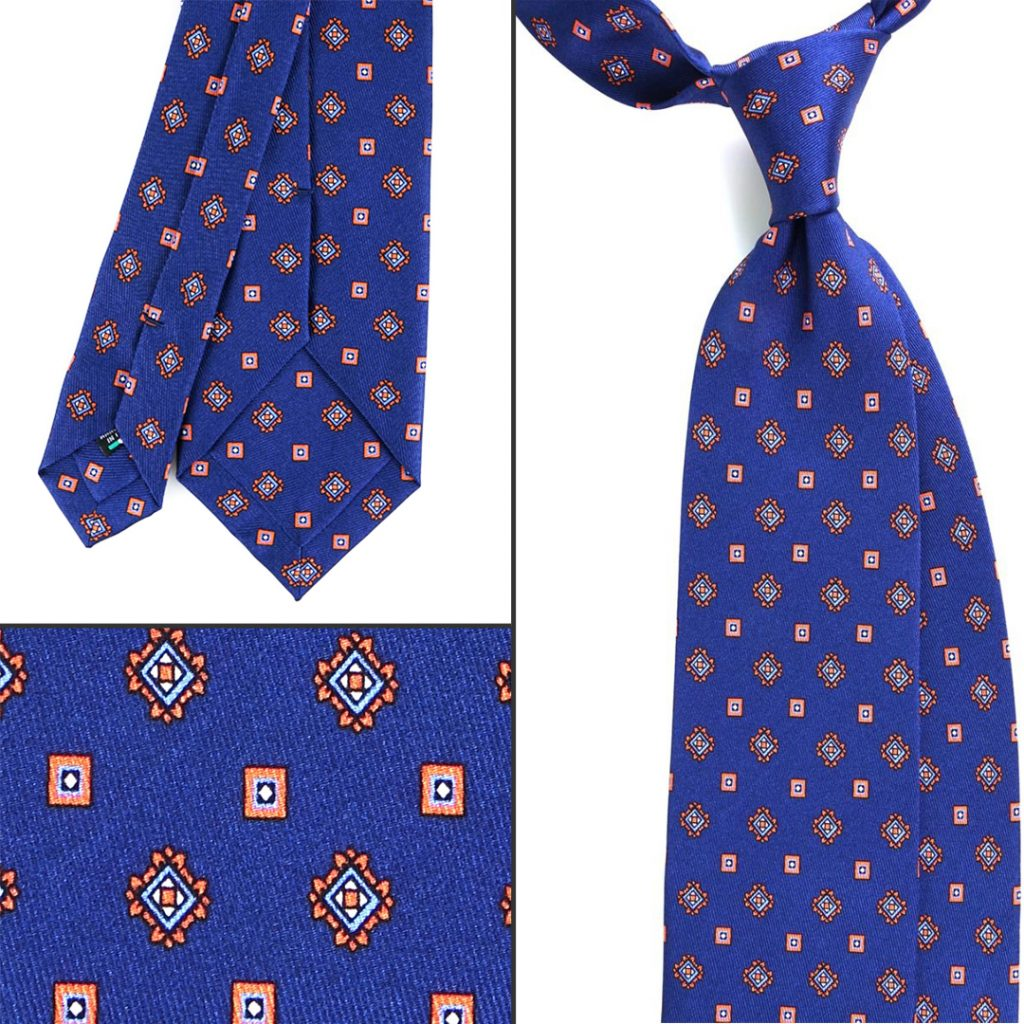 cravatta azzurra in seta a motivi geometrici